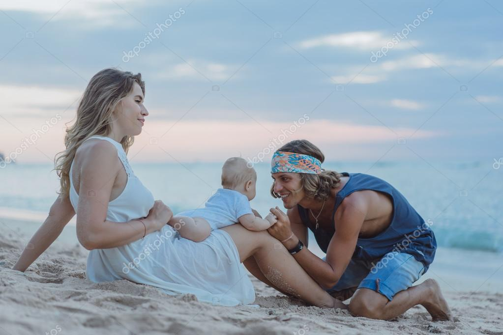 beautiful young couple in love with a child