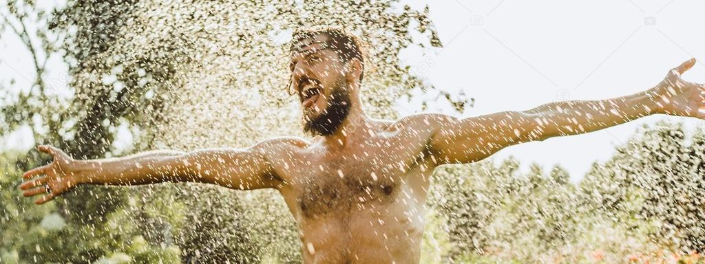 bearded man in green summer nature