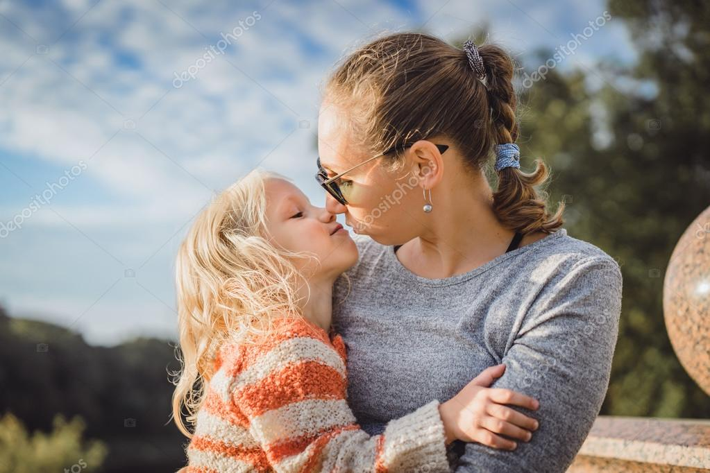 Young mother with cute daughter