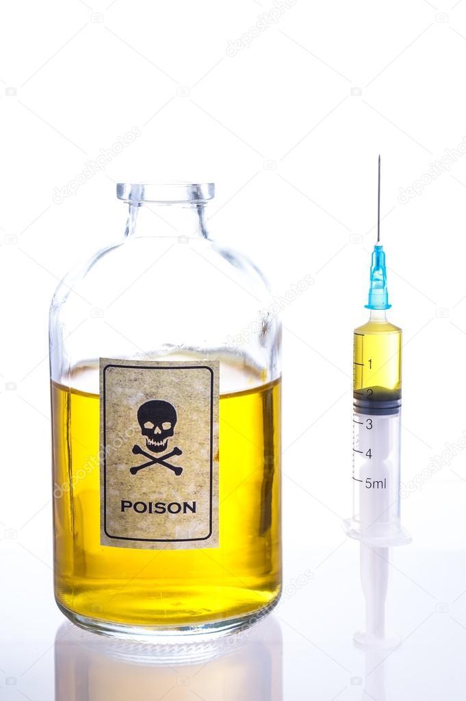 Poison and syringe — Stock Photo © Esbenklinker #64953855