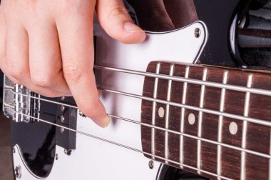Hands of an teenager plays guitar