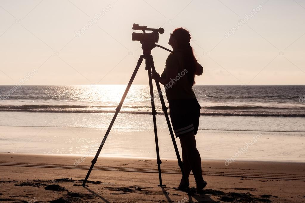 Silhouette Of A Woman Photographer