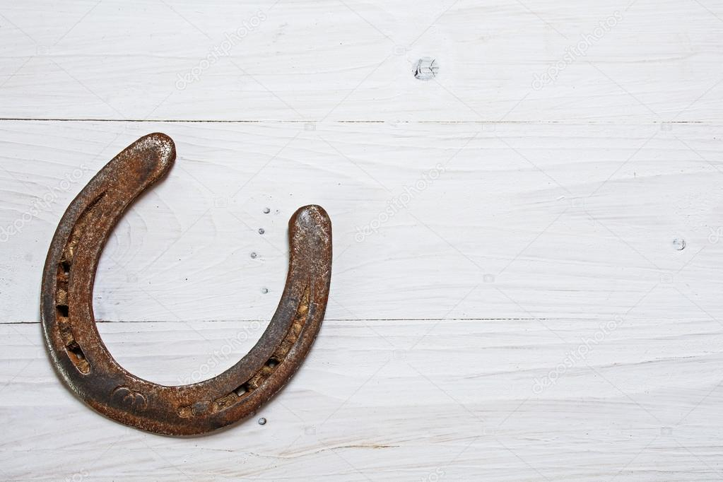 Lucky Horseshoe Used With Rust On White Painted Wood Luck Symbol