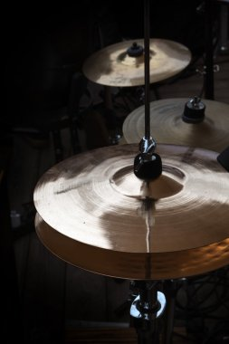 hi-hat and cymbals on stage, musical instruments in a percussion drum kit, dark background
