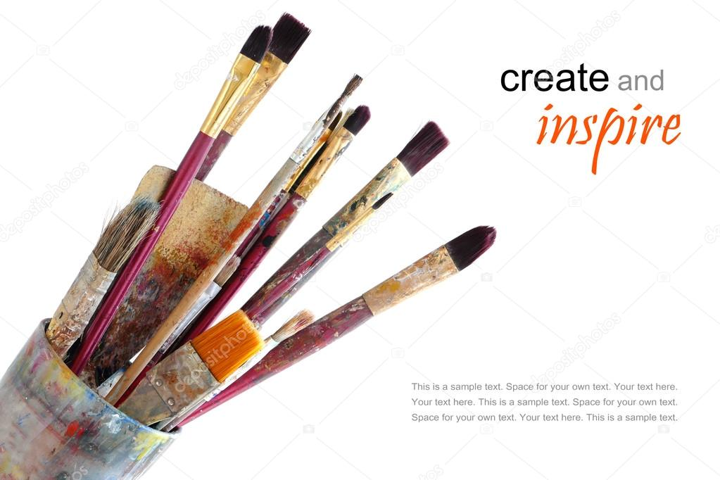 paint brushes in a glass, isolated on white background, sample