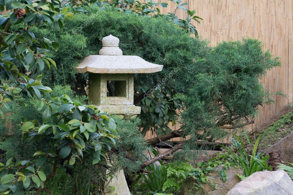 Stone lantern made of granite in a Asian garden