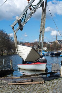 boat crane lifts the boat into the water, vertical