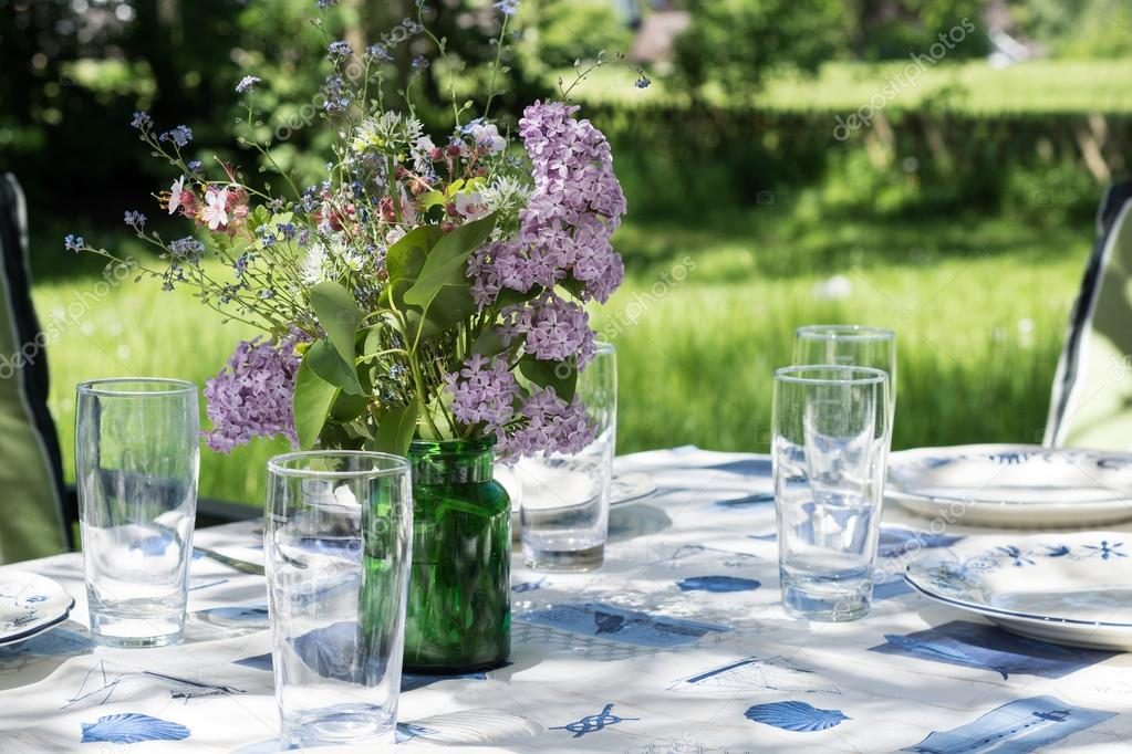 decorated garden table to eat outside in the early summer