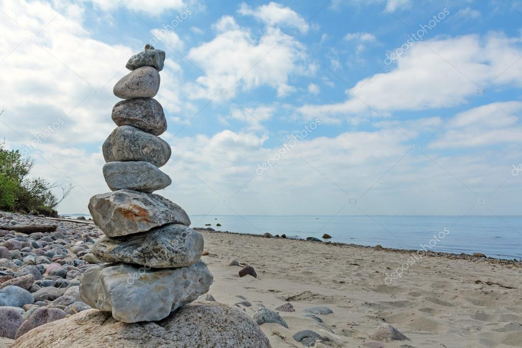 Balanced stones stacked to a tower on the beach of the Baltic Se
