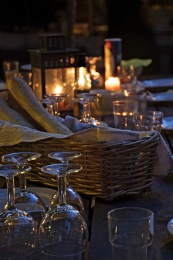 prepared table for a rustic outdoor dinner at night