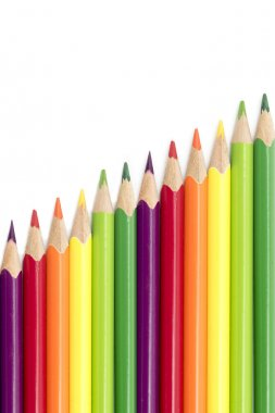 colored pencils  in a diagonal row isolated on a white backgroun