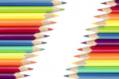 colored pencils  in two diagonal rows isolated on a white backgr