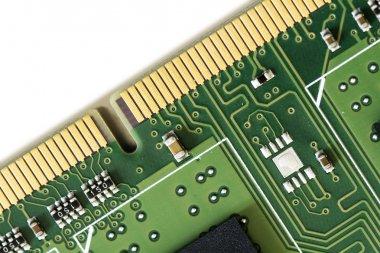 part of a computer ram memory barrette over white, macro shot