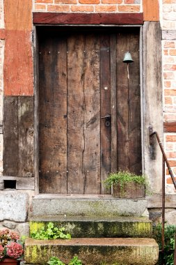 old wooden front door in a historic half timbered house