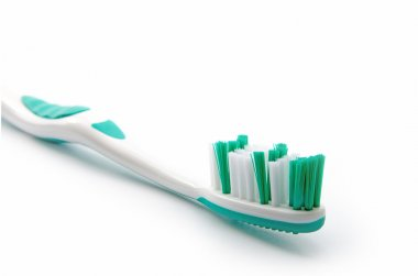 green toothbrush on a white background, close up