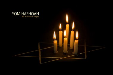 Yom HaShoah, burning candles and the star of David against black
