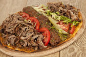 Photo Doner Adana Kebab with Lahmacun - Turkish pizza pide