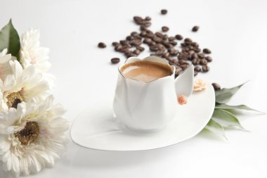 Traditional Turkish Coffee cup and beans concept tulip cup