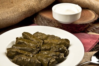 Dolma, stuffed grape leaves in a bowl, turkish and greek cuisine