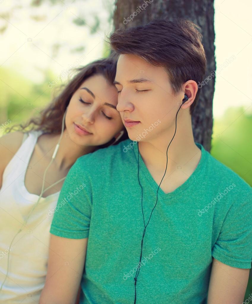 Vintage photo couple guy and girl in headphones enjoying music i