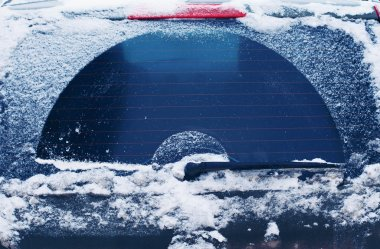 Winter frozen back car window, texture freezing ice glass backgr