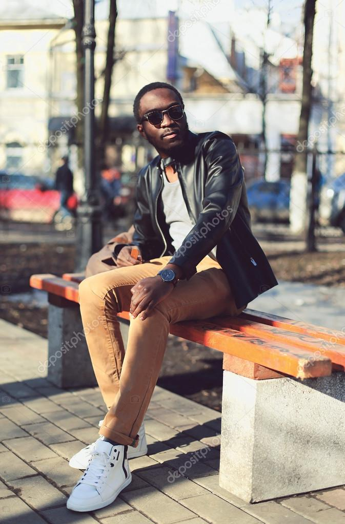 Fashion Young African Man Wearing A Sunglasses And Black
