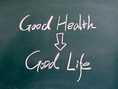Good health and good life words written on blackboard stock vector