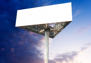 Blank white billboard against blue sky