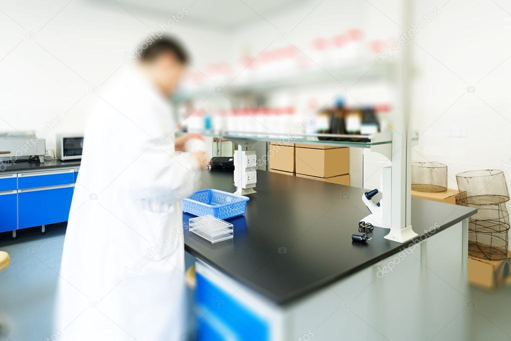 Researcher working in chemistry laboratory