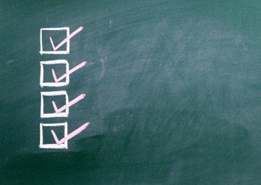 Check marks sign on blackboard
