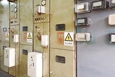 Electric measuring devices and switches are located on panels
