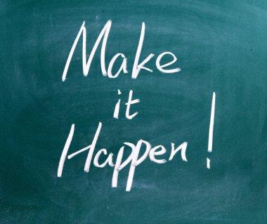 Make It Happen written in chalk on a used blackboard.