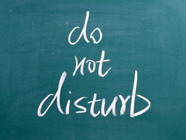 Do Not Disturb written on blackboard