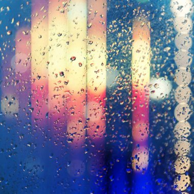 Wet window with night city
