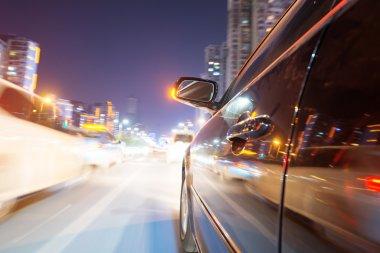 Car on road at night