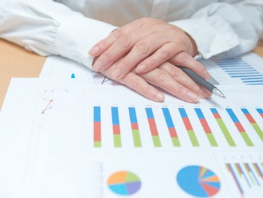 Woman hands with business report