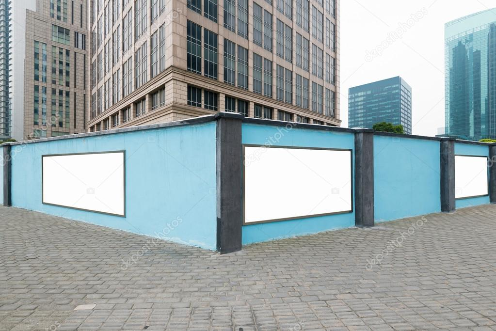 Blank billboards attached to a buildings exterior brick wall