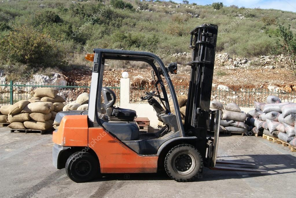 Forklift truck in a factory or a warehouse.