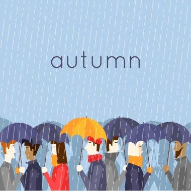 Autumn people with umbrellas