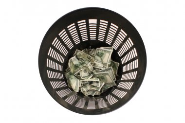 Money in the garbage can with clipping path