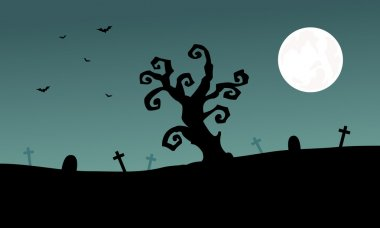 Halloween tomb and dry tree silhouette