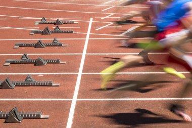 sprint start in blurred motion