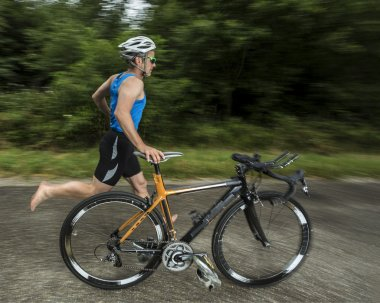 Triathlete with a bicycle
