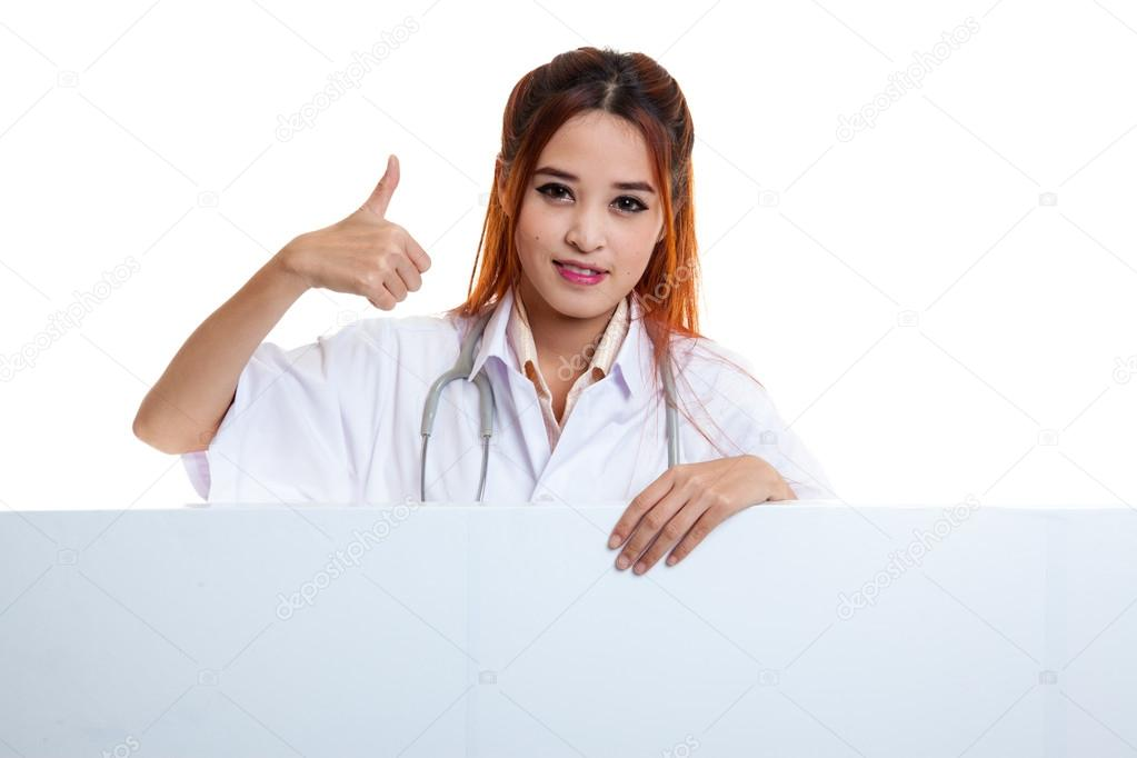 Young Asian female doctor show thumbs up behind blank white bil — Stock  Photo