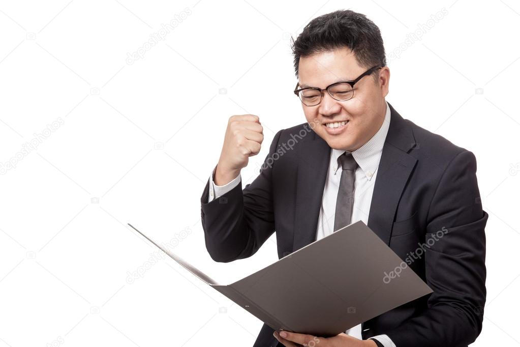 Asian businessman look at a folder happy with success