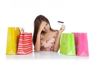 Beautiful Asian woman fed up with a credit card and shopping bag