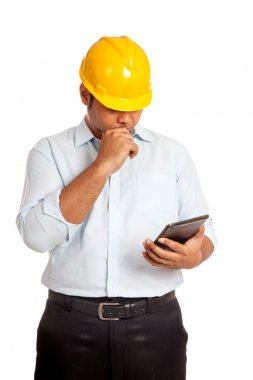 Asian engineer man thinking and looking at a tablet