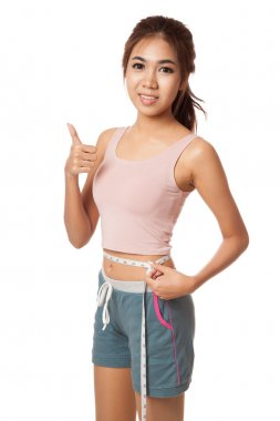 Asian slim girl with measuring tape show thumbs up