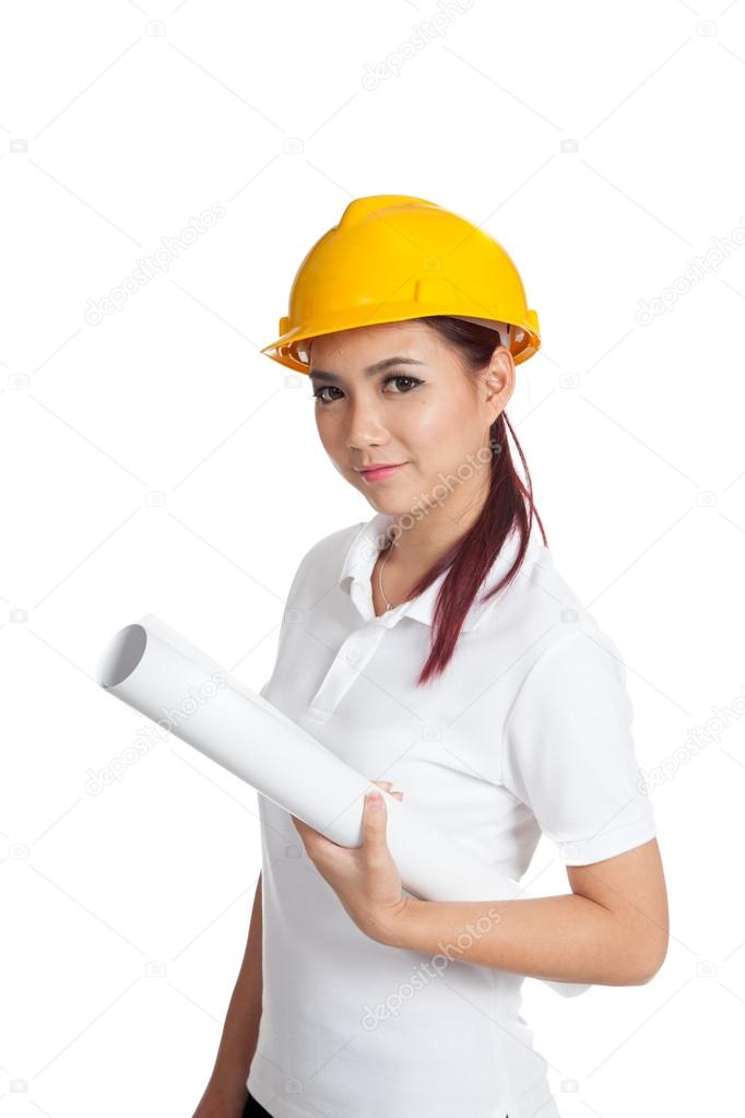 Asian engineer girl hold a blueprint and smile