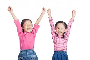 Asian twin sisters very happy  rise hands up